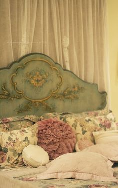 Love the pillows style. Ruffly and floral & vintage. Exactly what I want.