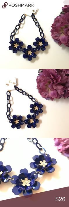 Large flowers royal blue necklace earrings set This is a new with tag set by Charming Charlie. The set consists of a necklace and earrings. Earrings are clear crystals studs. The necklace has 3 large flowers that are royal blue with gold and clear crystal centers. Look at the images and feel free to ask questions. Also feel free to check out my closet for more gorgeous listings. ❤️ Bundle and save. Charming Charlie Jewelry Necklaces