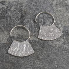 These stunning Hammered Grecian Silver Hoop Earrings have a unique textured…