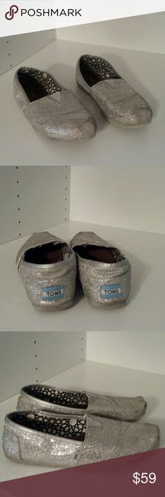 Silver Toms Toms silver sparkly shoes. Size 7.5. Some of the sparkles have come off from normal use which is typical for this kind. Soles have light wear on them with plenty of life left! More photos available upon request! These are super comfortable!  Sorry for the poor lighting..it's been raining here for DAYS! TOMS Shoes