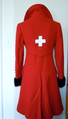 Every single swiss woman should wear this coat on LOL :)  1960s Gorgeous Fitted Lipstick Red Swiss Cross Military Coat, S via Etsy