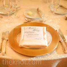 Each gold charger was topped with an ivory napkin and menu card printed with an elegant script font.