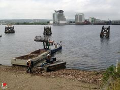 Cleaning the 'beach', Cardiff Bay, Wales