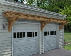 to Build a Pergola Above the Garage White steel garage doors accentuated with second panel windows and overhead arbor.White steel garage doors accentuated with second panel windows and overhead arbor. Pergola D'angle, Pergola Metal, Garage Pergola, Building A Pergola, Small Pergola, Pergola Attached To House, Pergola With Roof, Cheap Pergola, Pergola Lighting