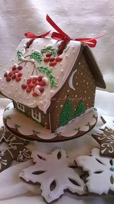Beribboned Gingerbread House and Snowflake Ginger Cookies.