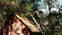 Up on another shed roof taking down old Coca Cola signs