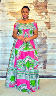 An easy to wear pull on maxi in a vibrant pink and green in a tiered gypsy style. Rock with flats or wedges and dress up or down to suit the occasion. In cooler weather,throw on a cropped jacket with a scarf and boots for versatility. The elastic smocking at the waist and back makes the fit flexible and gives a snug and flattering silhouette.  Please send a convo if you have any questions about the sizing.  Handmade in Ghana. 100% Cotton  Fits S/M/L UK 6-18, US 2-14 Length 52  Garme...