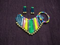 pom pom toy bangle and paper necklace with cardboard base and beads,pom pom toy is attached ...................