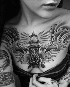 Tattoo lighthouse with Rose on chest  - http://tattootodesign.com/tattoo-lighthouse-with-rose-on-chest/  |  #Tattoo, #Tattooed, #Tattoos