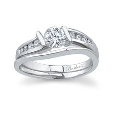 White gold diamond engagement ring set - 5803SW - This bridal set features a slightly twisting shank with a contemporary feel.  The diamond engagement ring has a low  profile and sports channel set diamonds gracing the center and shoulders of the ring.  A plain bright polished wedding band curves to shadow the side of the engagement ring.  Also available in yellow gold, 18k and Platinum.