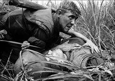 Catherine Leroy: 1967 US Marine with a wounded soldier, Vietnam