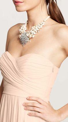Statement necklace + blush bridesmaid dress