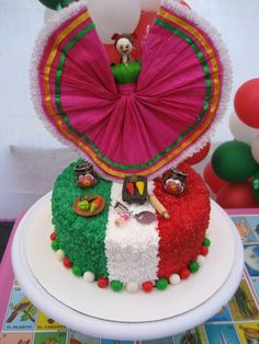 Spanish dancer cake! Even with out the dancer this cake would be great on any table. CINCO DE MAYO!!