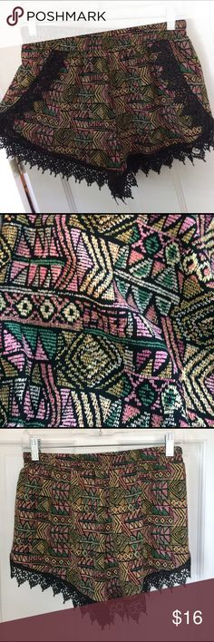 Flow-y & Patterned Stretchy Shorts Black lace trim, stretchy band on waist, colorful shapes make up this exciting pattern! Shorts