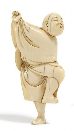 NETSUKE: SPARROWDANCER, IVORY End of the 2nd half of the 19th Century. A sparrowdancer in a wide-sleeve robe in a dance-like posture with his left leg raised, standing on the other leg. Both arms held skywards to the right. Dreamily whistling. Delicately carved and polished. Beautiful, shiny, verso yellow-gold patina. H. 6,6