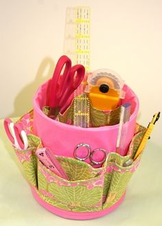 Coffee Can Cover Craft Organizer from Flower Girl Design Etsy Shop via It's So Very Cheri. I have to make one or two of these! :)