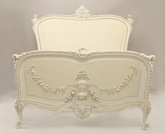 French Louis XV style queen size white painted bed with carved urn & swag details Price $9,500.00
