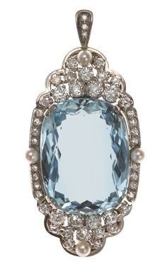 An aquamarine, diamond and seed pearl pendant/enhancer cushion-cut aquamarine weighing approximately: 31.00 carats; estimated total diamond weight: 3.00 carats; mounted in fourteen karat white gold; length: 2 1/8in.