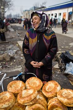 uzbek woman from englishrussia.com...I don't know what those are but they look good! Notice the streets. this must be a very poor country. It is hard to find any pictures of the landscape because most of it is sand and some mountains. A very poor place except for the mosque.