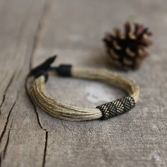 Gray high quality Japan Toho beads and linen natural string mens bracelet.