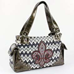 NEW !! DESIGNER INSPIRED FLEUR DE LIS- CHEVRON PATTERN  PURSE.  HAS ZIP TOP CLOSURE.  MEASURES APPROX. 15 INCHES WIDE BY 9 INCHES TALL AND 6  INCHES DEEP. REALLY PRETTY!!!!
