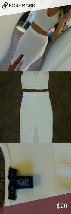 Brand New White Two Piece Set Two piece white set with slit in front of skirt. Never worn out. Bought for my Bachelorette Party and ended up wearing another outfit. Great condition. Bright white. Fitting and sexy.  You can dress it up or down! Make me a offer :) Dresses