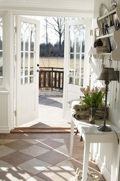 Love the white french doors with a bench seat to the left under the window in our kitchen
