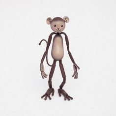 Made to Order:  This posable primate is designed for maximum monkey business! This Bendy is all smiles and Kawaii cuteness!  * Head tilts and rotates, neck bends * Shoulders have full range of motion * Wrists, arms and elbows bend * Ankles, legs and knees bend * Fingers and toes bend and curl  Color: Brown Size: 4 1/2 x 1  Handmade using our durable proprietary armature, paper clay and non-toxic acrylic paint.  Bendy Friends make wonderful gifts, as well as holiday ornaments.  IMPORTANT:...