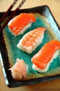 How to Make Nigiri Sushi: a small oblong-shaped ball of rice with a little wasabi paste and fish on top | willcookforfriends にぎり寿司
