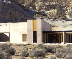 the complex uses a mix of local materials and powerful geometries to create a balanced relationship with the unique desert landscape that hosts it.