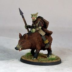 This is a new addition to the Pig-faced Orc range, a spearman mounted on a Giant Boar. The orc was sculpted by Kev Adams, and the boar by Jo Brumby. Kev Adams, Fantasy Creatures, Sculpting, Lion Sculpture, Miniatures, Statue, Face, Animals, Minis