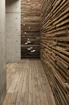 Wood Detailing in  in a entrance passageway   Learning Center / Sebastian Mariscal Studio 05   Lath wood walls