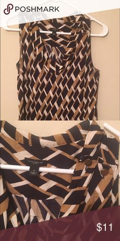 Ann Taylor sleeveless top, size 4 This too is beautiful and so soft! It has a great geometric shape with light brown, cream, and navy shapes. I am a former store manager, so I've worn this top maximum 6 times, so it's in pretty good shape. Ann Taylor Tops Blouses