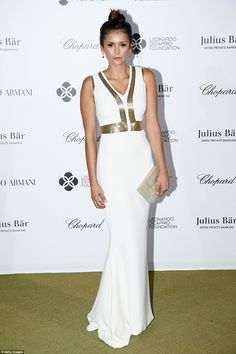 Simply stunning: Nina Dobrev looked gorgeous in her figure-hugging white dress with a meta...