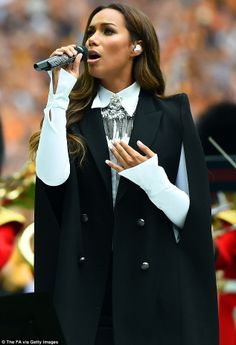 God Save Our Queen: Leona Lewis took to the pitch to sing the national anthem before the FA Cup final between Arsenal and Hull City at Wembley Stadium on Saturday