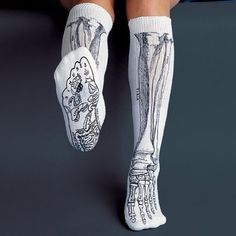 The bones in your lower leg and foot are shown on knee length socks. Soles show reflex points. Go skinless with this amusing design and learn the real names for your big toe, shin bone and more. Knee length. Adult sized. 70% acrylic, 25% cotton, 5% elastic. Please allow 1-2 weeks for delivery.