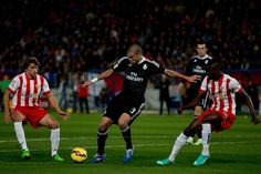 Pepe (L) of Real Madrid CF competes for the ball with Joaquin Thomas Teye Partey (R) of Almeria UD during the La Liga match between UD Almeria and Real Madrid CF at Juegos del Mediterraneo stadium on December 12, 2014 in Almeria, Spain.