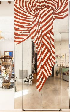 Red and white striped painted mirror in the entryway of alice + olivia creative director and CEO Stacey Bendet's New York home. Space Interiors, Shop Interiors, Wall Pannels, New York Homes, Whimsical Fashion, Conceptual Design, Contemporary Interior Design, Mirrored Wardrobe, Red And White Stripes