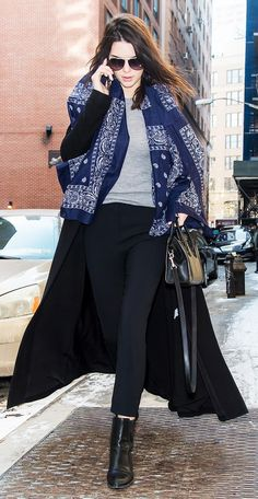 Kendall Jenner in a duster jacket, tank, and lightweight scarf