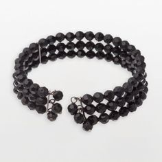 Vintage Jet Black Beaded Bracelet | Get a jet-setting look with this stylish bracelet! Featuring three strands of jet stones. With dangling, beaded accents on the opening for a delicate touch. And a coil design that's easy to slide on and off. A great accessory for almost any outfit!