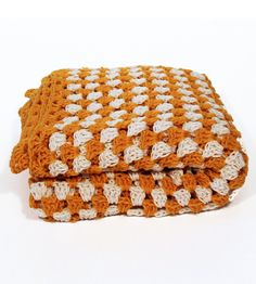 Add some much-needed color to just about any room with this vibrant, retro-inspired blanket. It's crocheted by hand, using vintage techniques in a lovely yellow and white checkered pattern. And while we prefer to toss it over the back of our sofa as a sort of makeshift slipcover, we hear the crocheted blanket's mighty fine for snugglin' in too.
