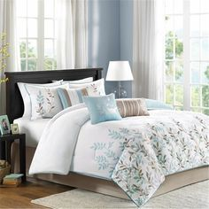 "The Meadow Bedding Collection uses a modern approach to the floral design. Made from 200 thread count cotton sateen, the comforter and shams feature an embroidered leaf pattern that goes about halfway up the comforter. A solid white background includes a 1"" flange in a light blue color to pull from the color used in the embroidery. Three decorative pillows use embroidery, pleated fabric and stripes to accentuate the colors used in this set."