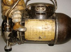 Anonymous Works: 1920's Michelin Man Cast-Iron Air Compressor