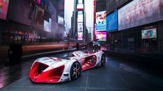 """Roborace showed off its electric self-driving race car in the middle of Times Square  The robotic racing series Roborace is still somewhat of a pipe dream that aims to become the """"world's first self-driving racing series."""" On Friday we got our first in-person look at the 200-mph vehicle that will eventually race itself around the track: the Robocar.  The sleek brightly colored racer was plopped down in New York City's Times Square attracting the attention of NYC locals and tourists who just…"""