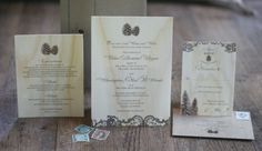 Pine cone winter wedding invitations... on wood.  From www.whiteaisle.com