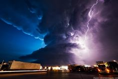 Lightning Storm Over A Truck Stop In York, Nebraska by acclaimed storm photographer Mike Hollingshead.