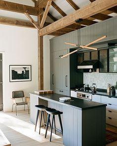 Gray kitchen, exposed beams