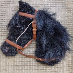 Black horse head wreath with leather bridle. This is available for purchase $65 plus shipping