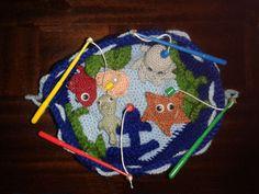 Angelspiel mit Anker, Seestern, Muschel, Fisch, Seepferdchen und Krake