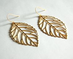 Gold Leaf Earrings gift mother sister by CorinnaMaggyDesigns, $21.00 http://corinnamaggydesigns.com nature inspired leaf earrings. Women's fashion, Jewelry and Accessories